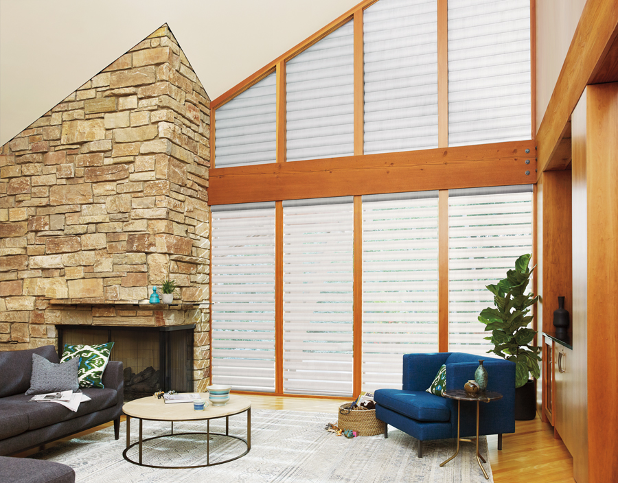 White with warm wood tones living room pirouette shades Hunter Douglas San Antonio 78249