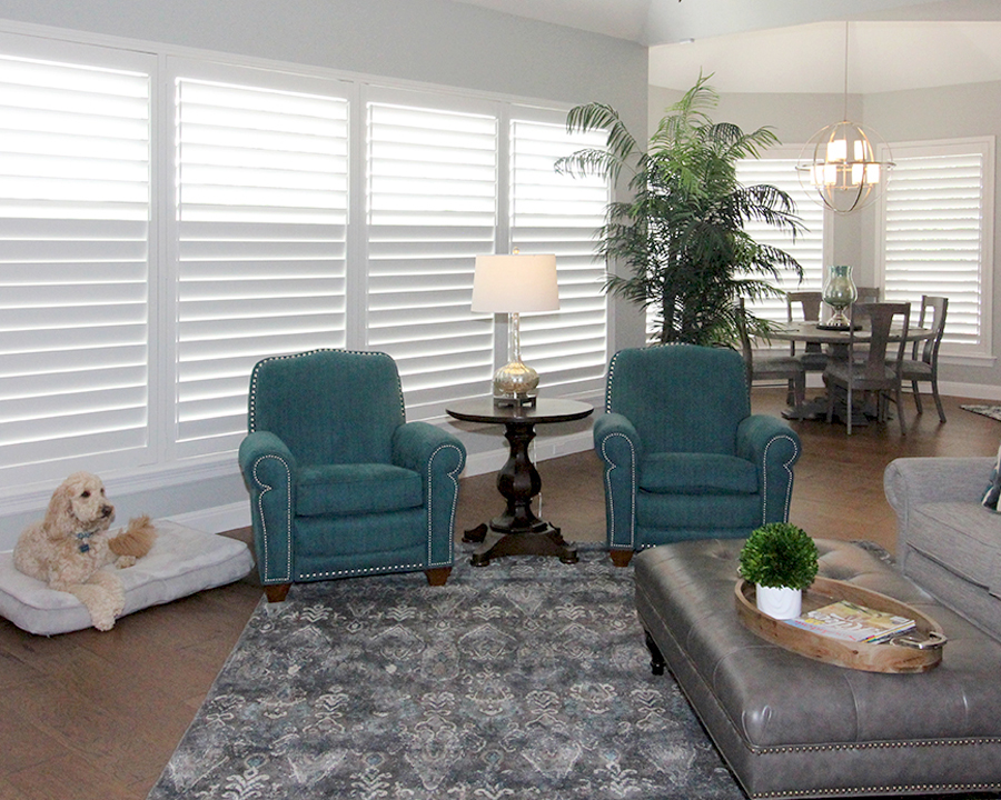 family room plantation shutters covering floor to ceiling windows Hunter Douglas San Antonio 78249