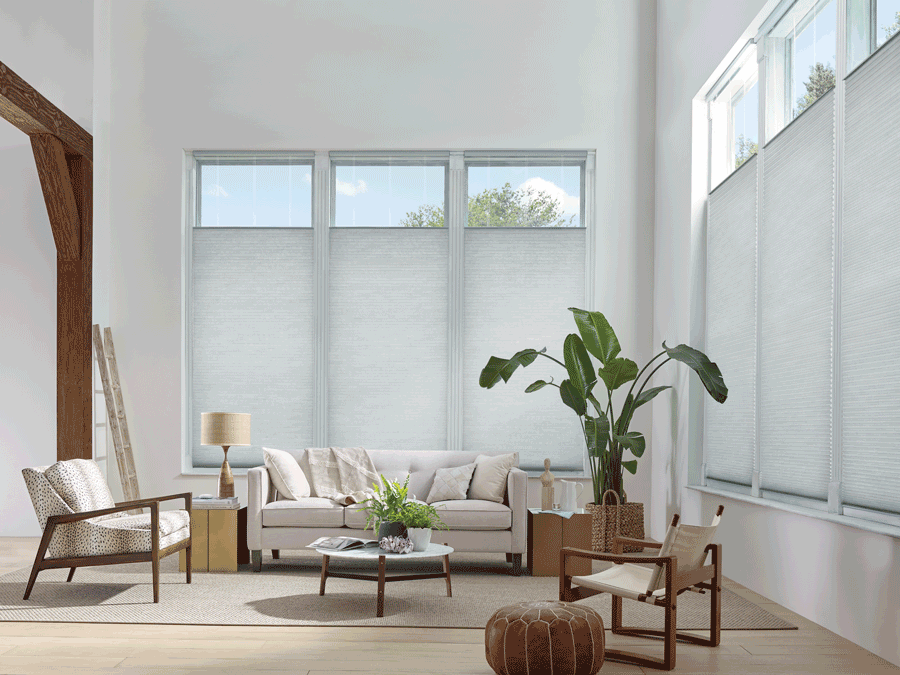 Living room showcasing top down bottom up shades which are on list of favorite features.