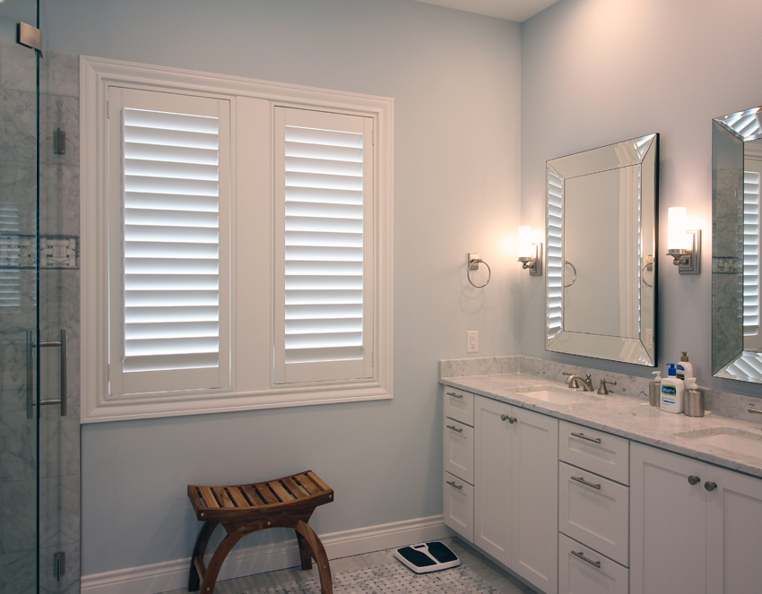 energy efficient window treatments bathroom with white plantation shutters San Antonio 78249