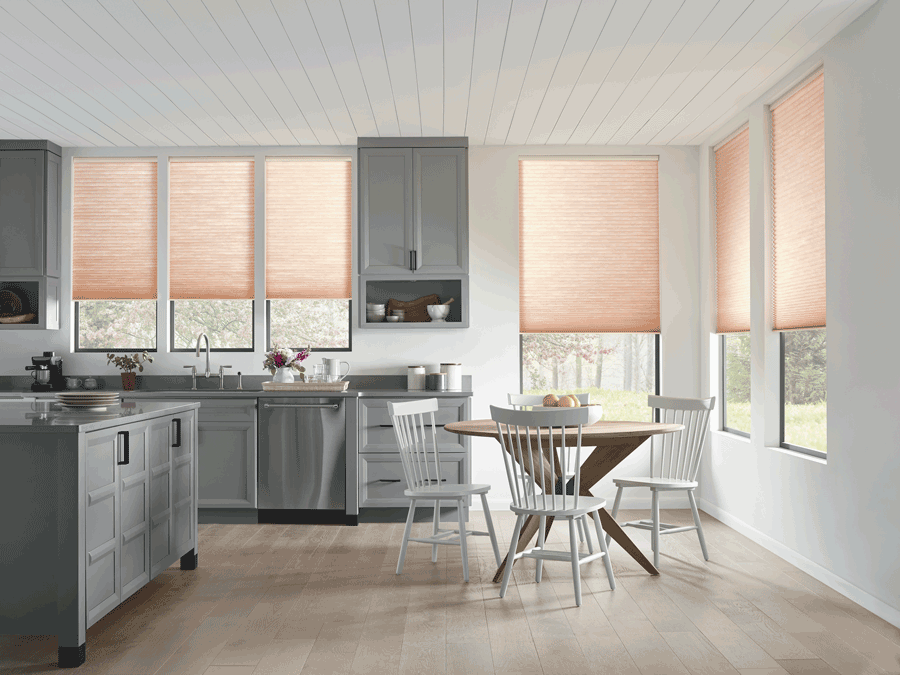 Kitchen with modern taste and motorized shades that are half drawn. Shades are on list of favorite features.