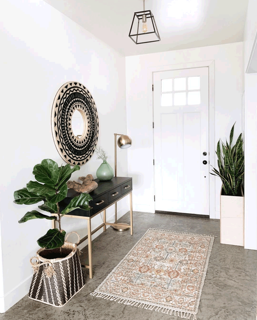 entryway styled with green black and gold modern desert living