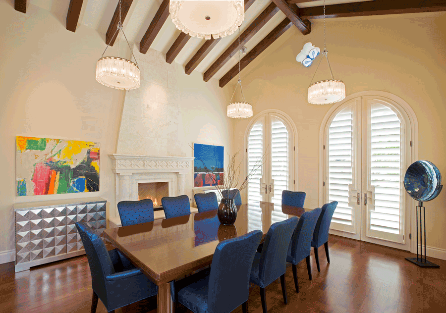 Plantation shutters on arched doorways in a San Antonio dining room.