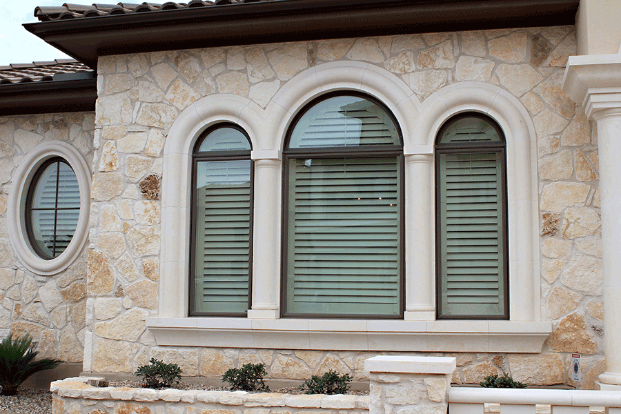 Exterior view of plantation shutters on the inside of a San Antonio home.
