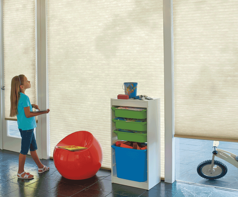 San Antonio home with motorized shades, important for child safety.