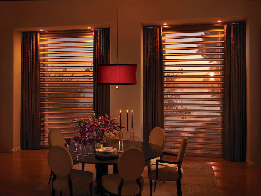 Pirouette shades filter the seasons light through sheer fabric backing.
