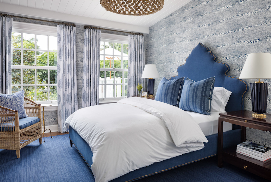 blue headboard blue grasscloth wallcovering blue patterned curtains in bedroom