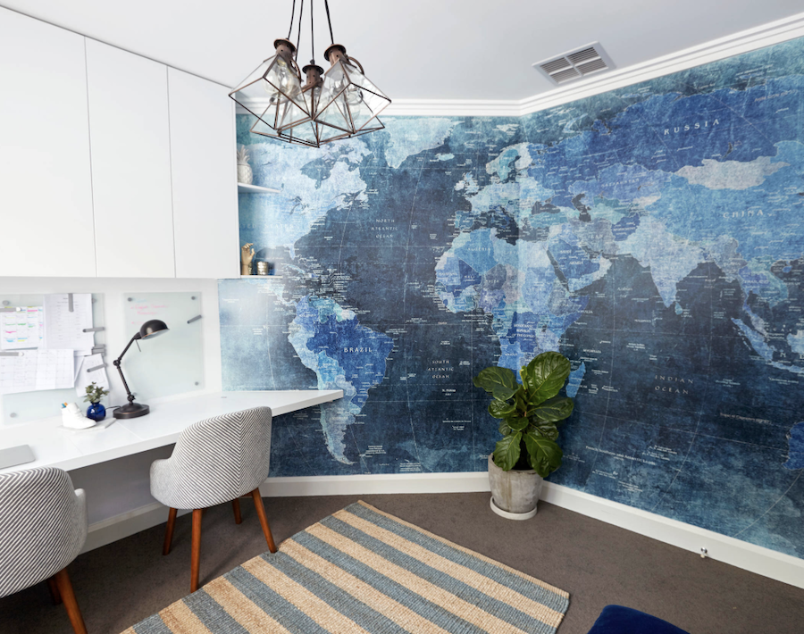 home office with blue wall map mural
