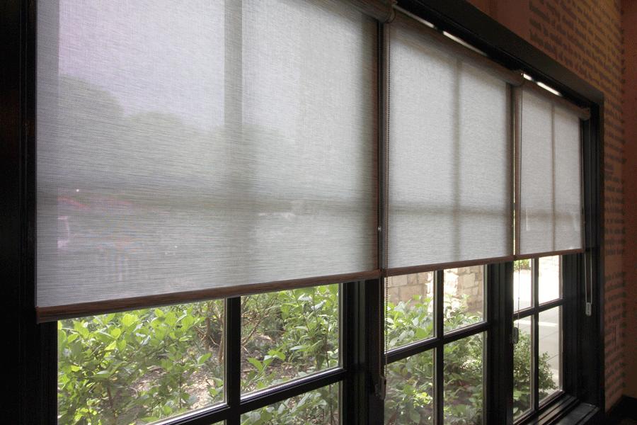 black window trim with gray roller shades San Antonio
