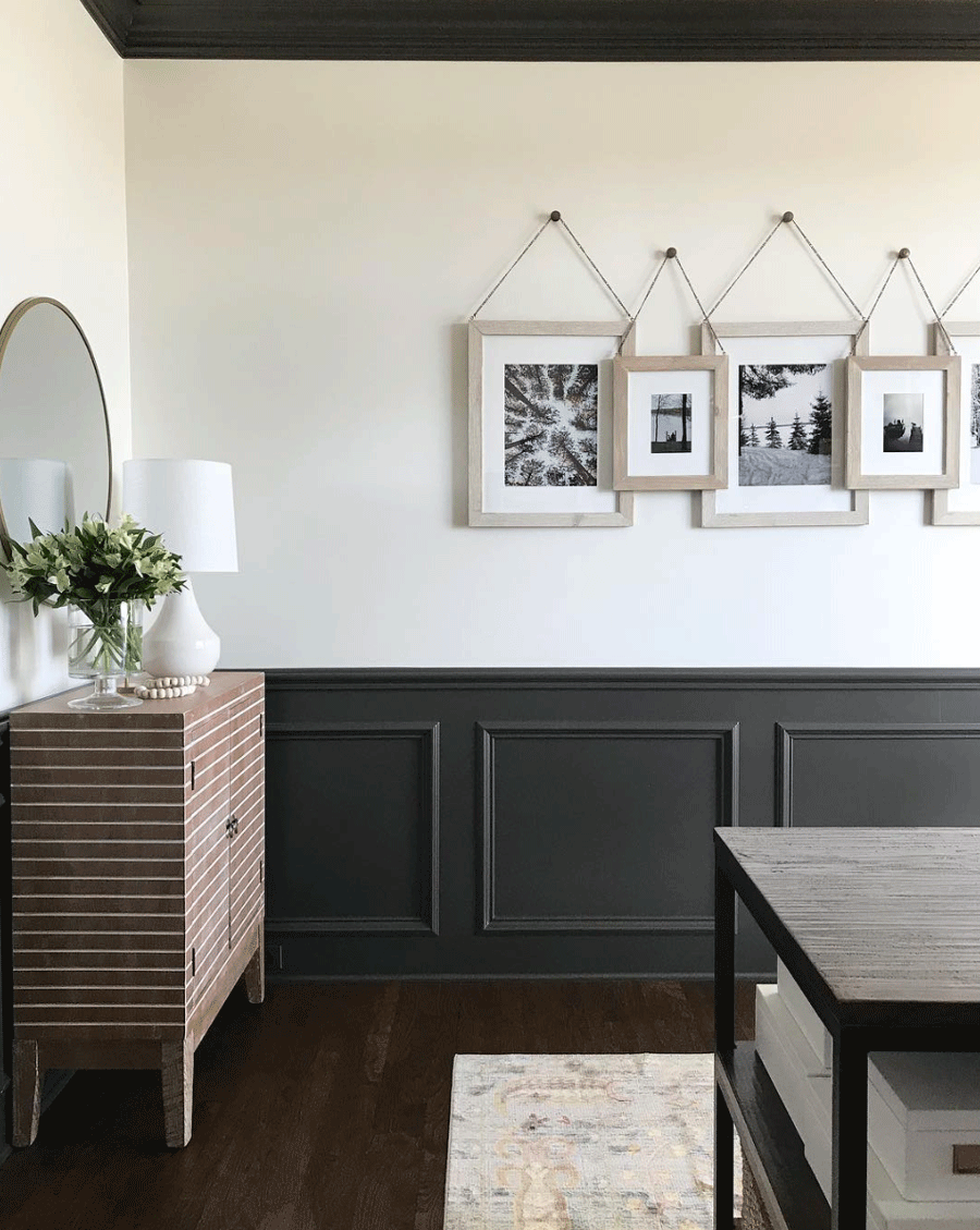 black board and batten with gallery wall black and white photos