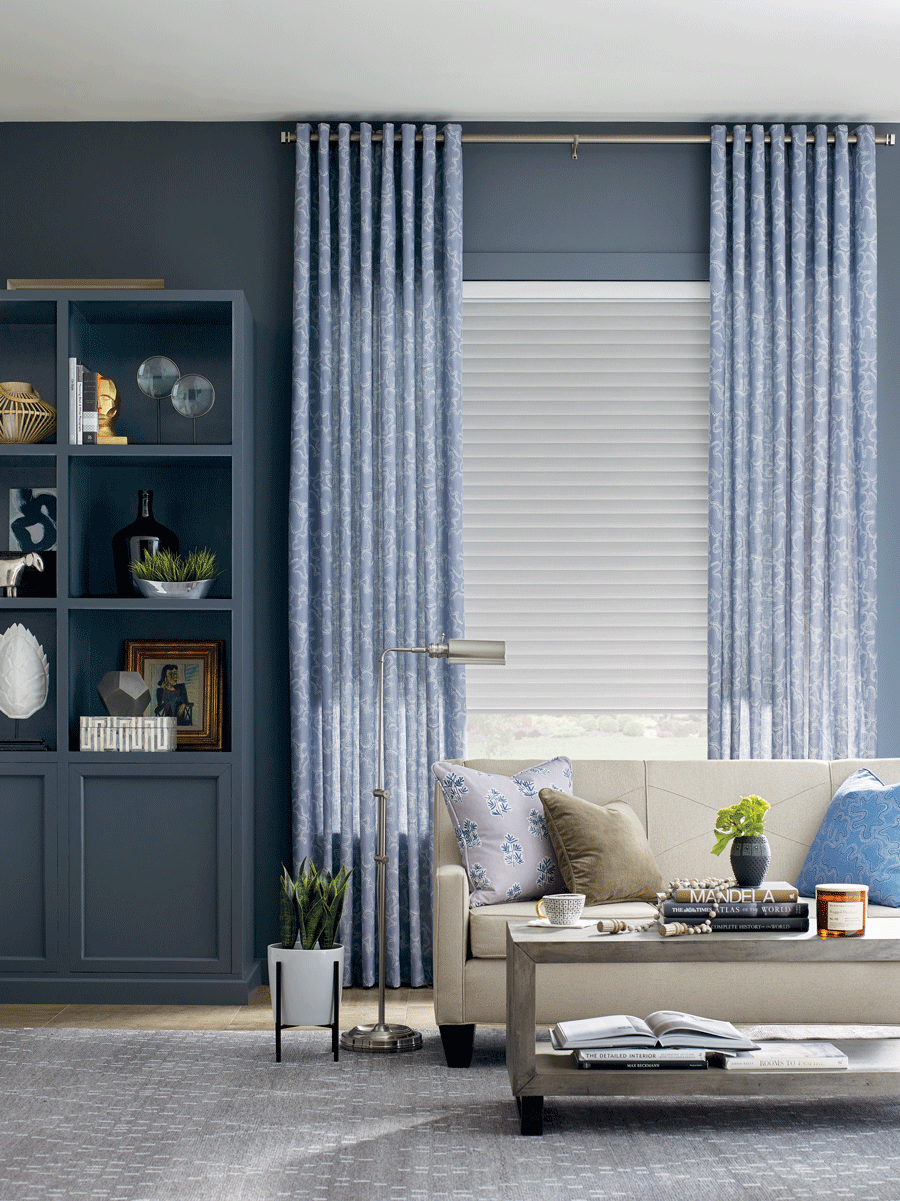 living room with blue draperies to layer window treatments with roller shades San antonio TX