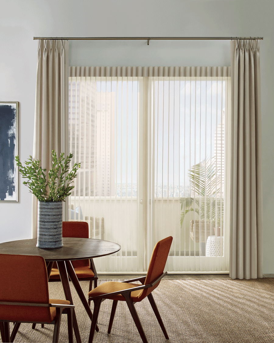 Privacy sheers and side drapery panels on sliding glass doors.