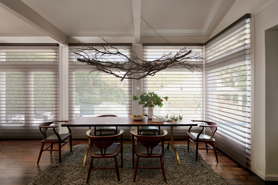 Sheer window treatments on dining room windows.