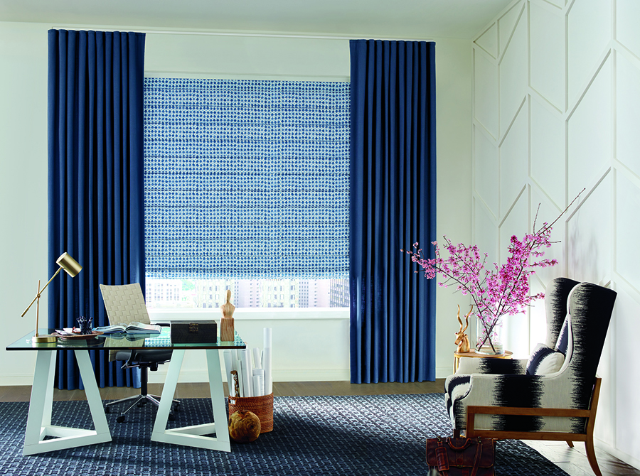 blue draperies and patterned roman shades