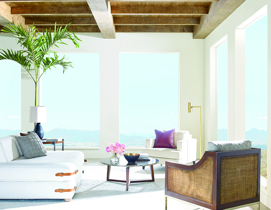 Full view of living room with bare windows energy savings shades in San antonio home