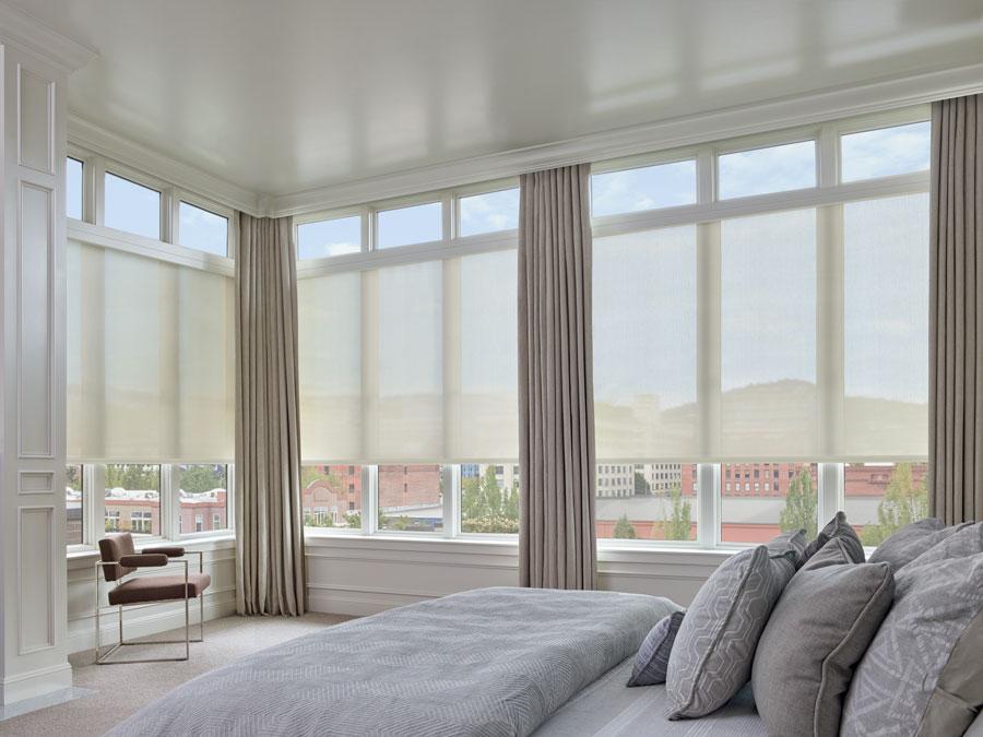 Designer screen shades on floor to ceiling windows
