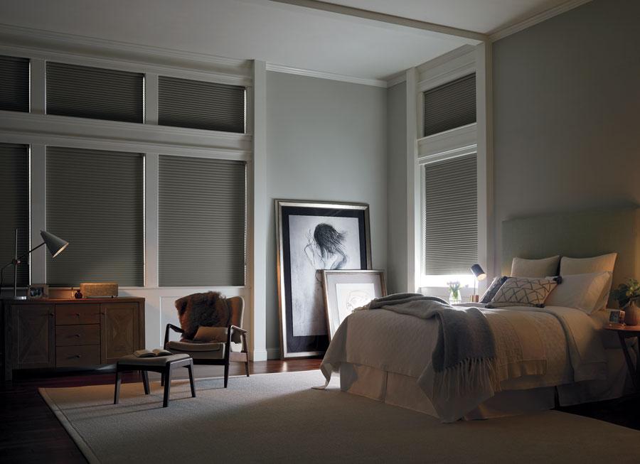 charcoal gray honeycomb shades in bedroom in San Antonio TX