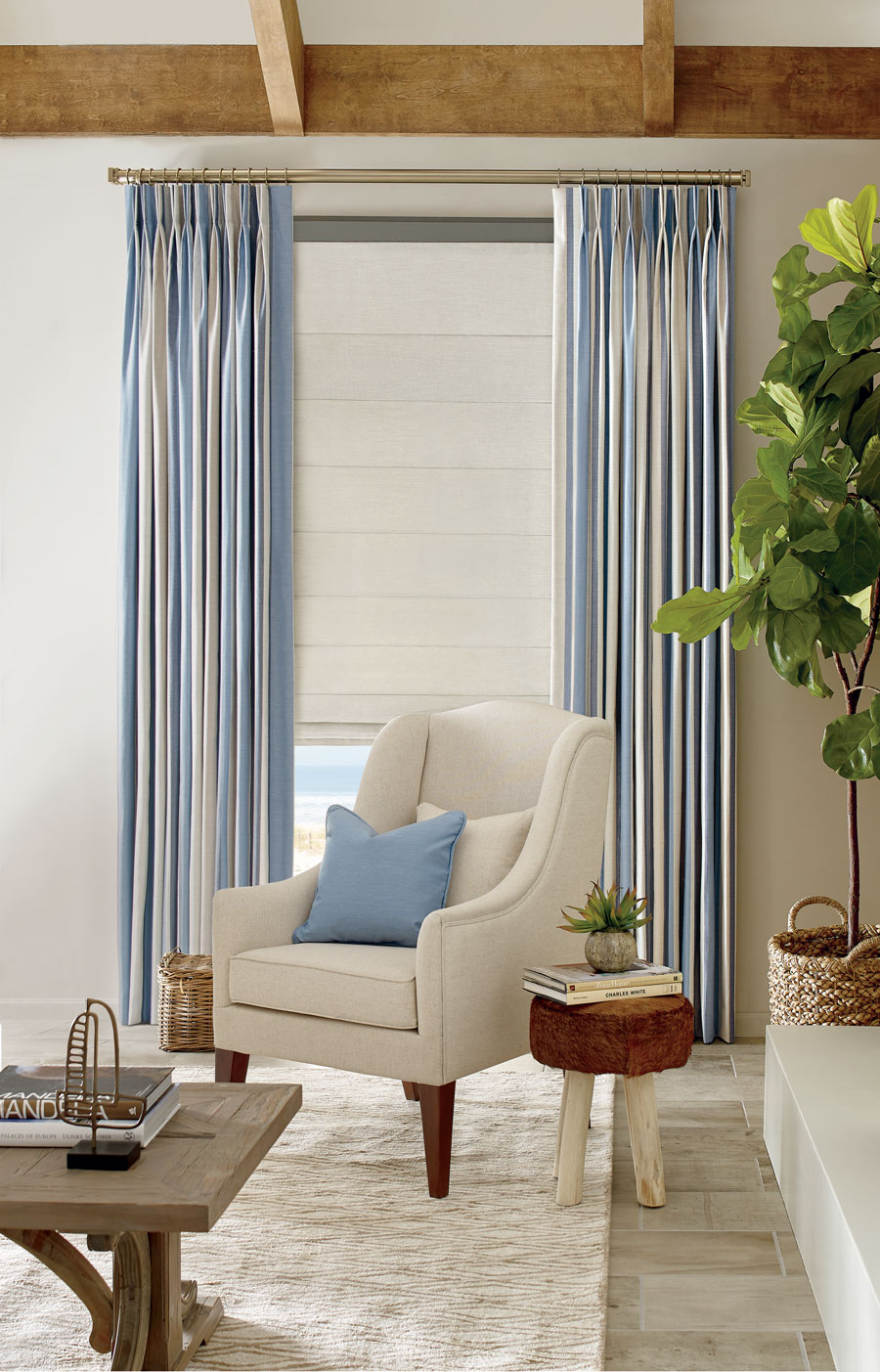 Blue striped draperies on large window