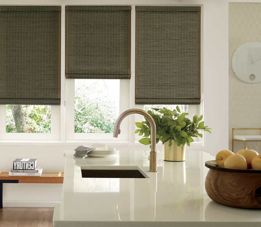 three kitchen windows Hunter Douglas woven wood shades San Antonio