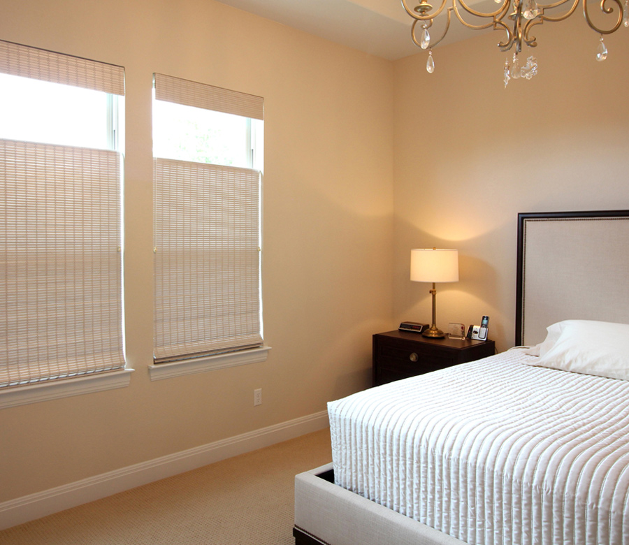 contemporary guest bedroom with woven wood shades in San Antonio TX