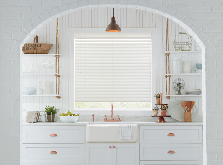 all white kitchen with open shelving and white wood blinds san antonio TX
