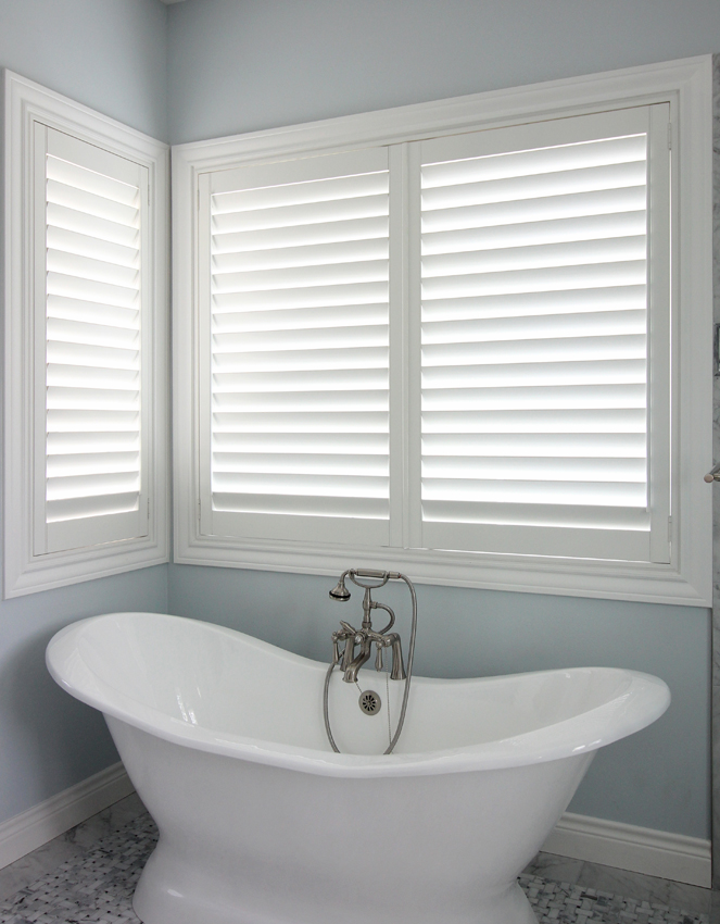 bathroom with stand alone bath tub and interior shutters San Antonio 78249