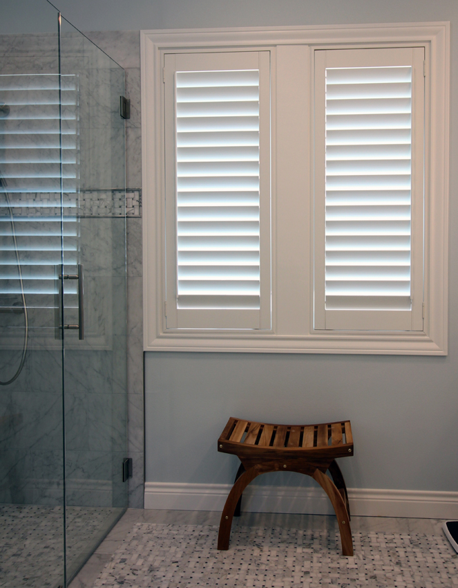 contemporary bathroom with walk in shower and white plantation shutters San Antonio 78249
