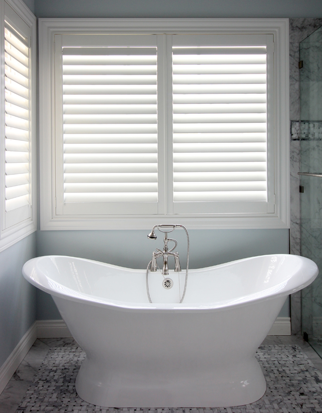 bathroom stand alone bathtub white plantation shutters San Antonio 78249