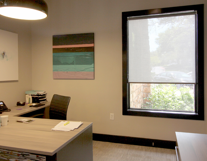 commercial office space with hunter douglas roller shades on Large windows in San Antonio