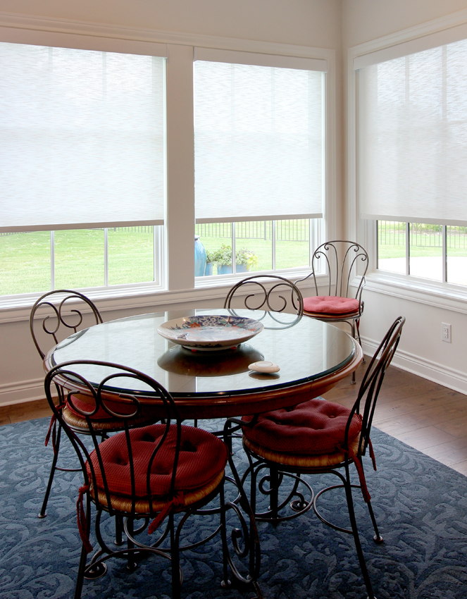 breakfast nook with Hunter Douglas designer roller shades Antonio 78249