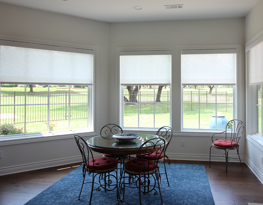 family dining room with Hunter Douglas designer roller shades San Antonio