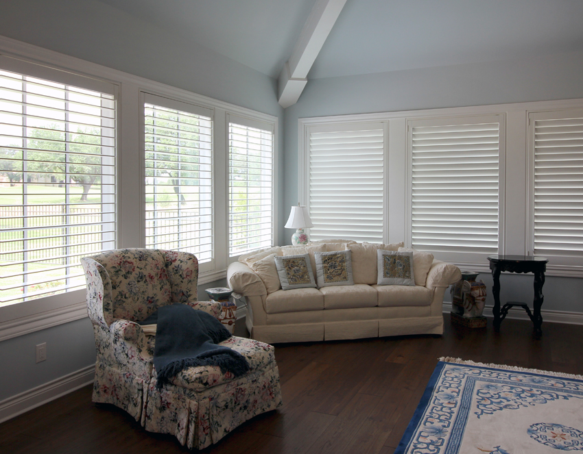 traditional living room floral armchair and large window plantation shutters San Antonio