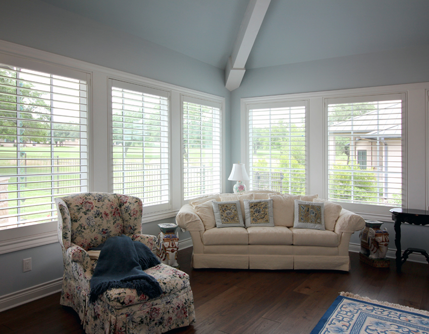 family room floral armchair and white interior window shutters San Antonio 78249