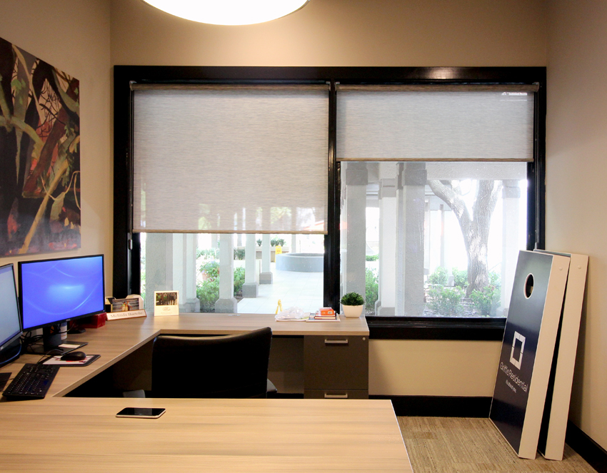 corporate office with large windows and hunter douglas screen shades San Antonio 78249