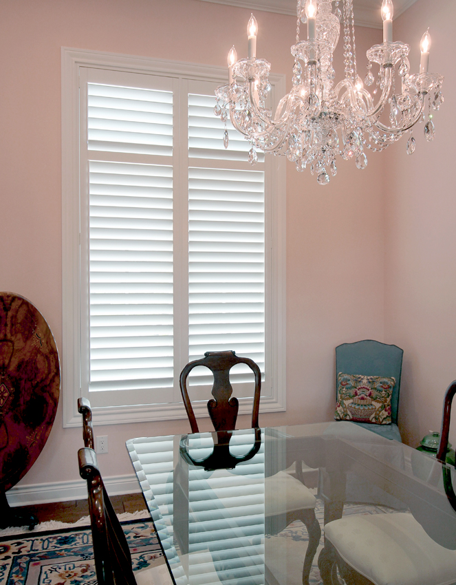 pink dining room glass chandelier and white interior shutters San Antonio 78249