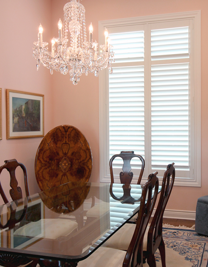 pink dining room with white plantation shutters San Antonio