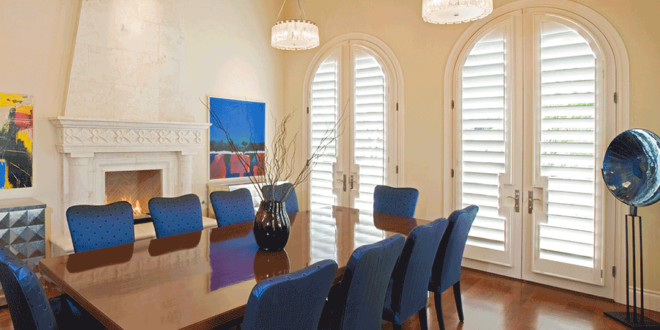 Arched french doors with plantation shutters in dining room San Antonio