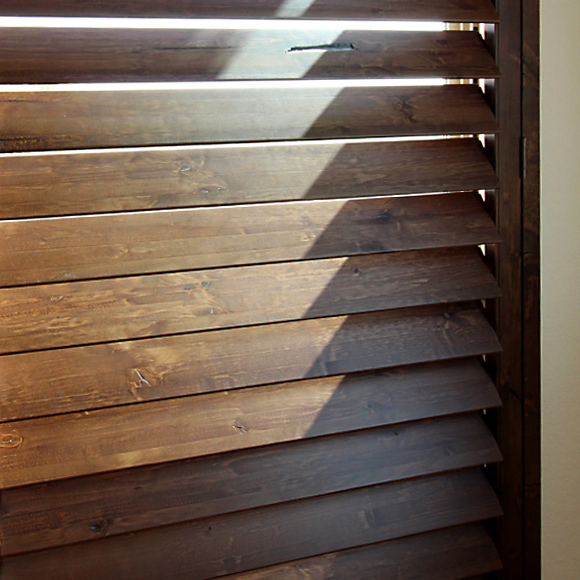 stained brown wood interior shutters Knotty Adler stained shutter options San Antonio 78249