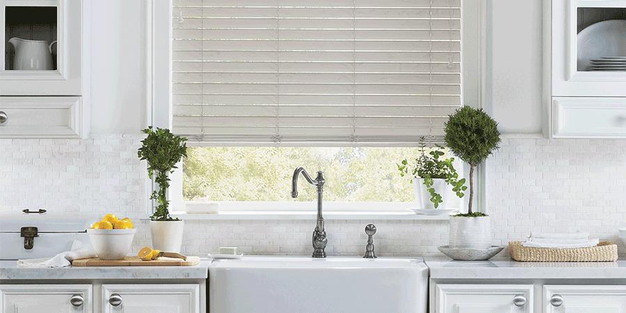 Farmhouse window treatments above kitchen sink in San Antonio home.