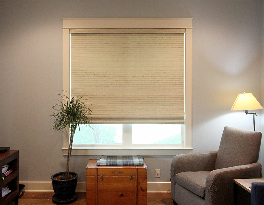 living room with hunter douglas woven roller shades San Antonio