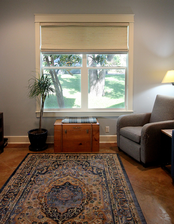 boho living room with woven roller shades Hunter Douglas San Antonio 78249