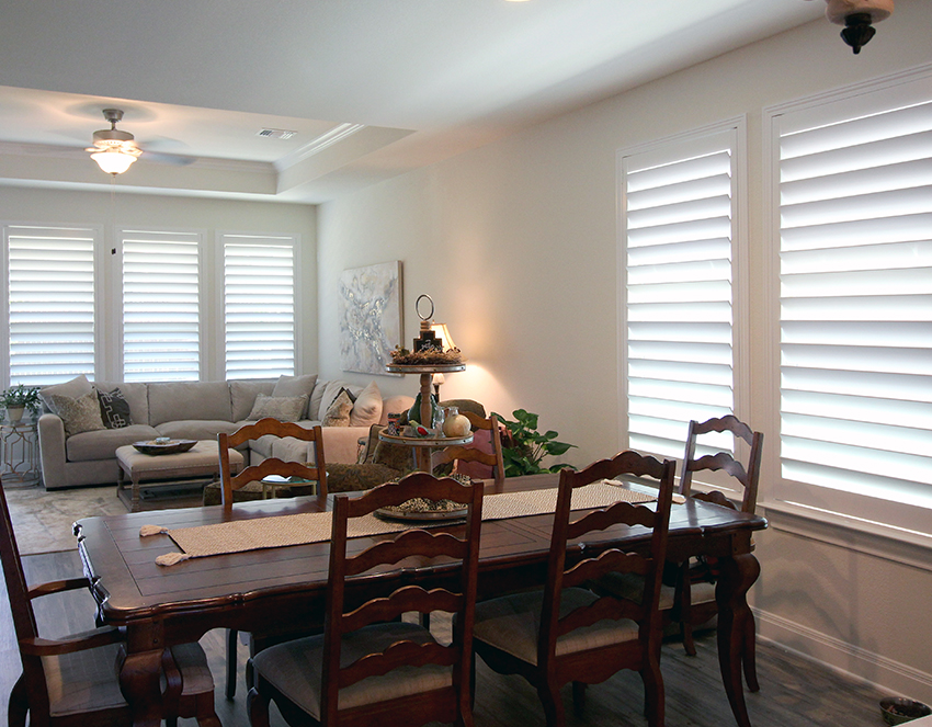 dining room with white wood shutters on large windows San Antonio 78249