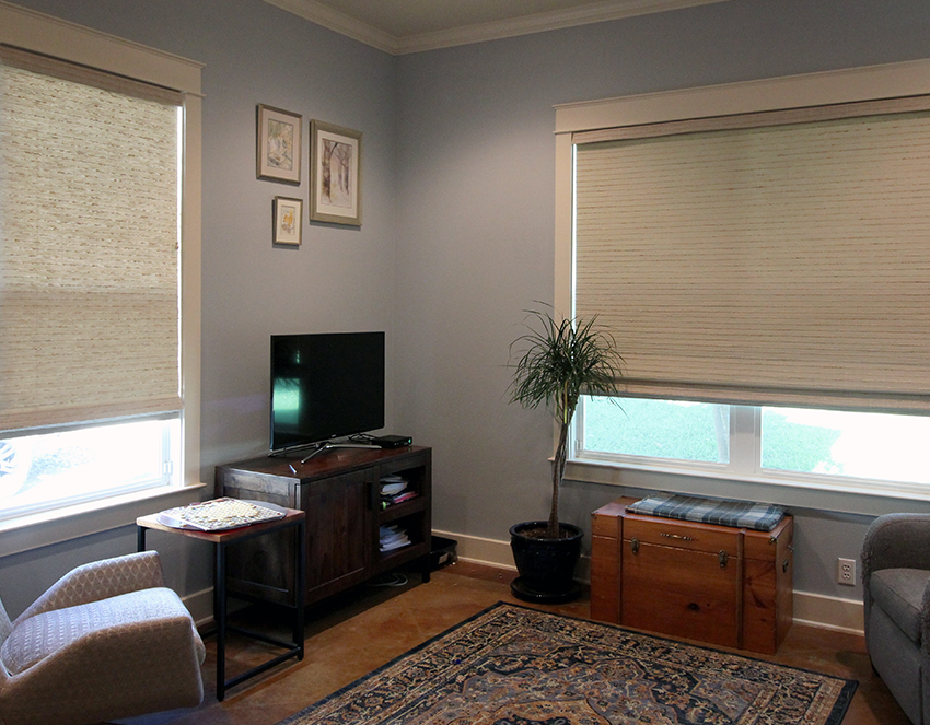 bohemian living room hunter douglas provenance woven wood shades on large windows San Antonio 78249