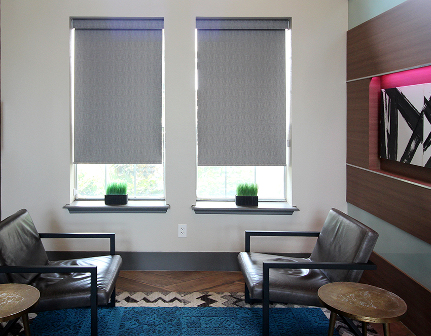 commercial office with hunter douglas designer roller shades San Antonio
