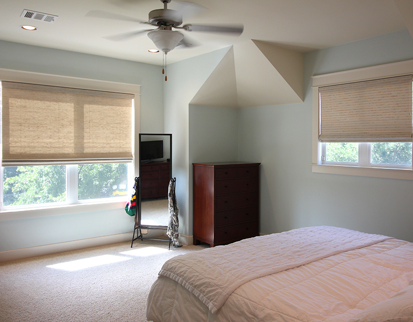 light blue bedroom with hunter douglas provenance woven wood shades commercial office with hunter douglas designer roller shades San Antonio