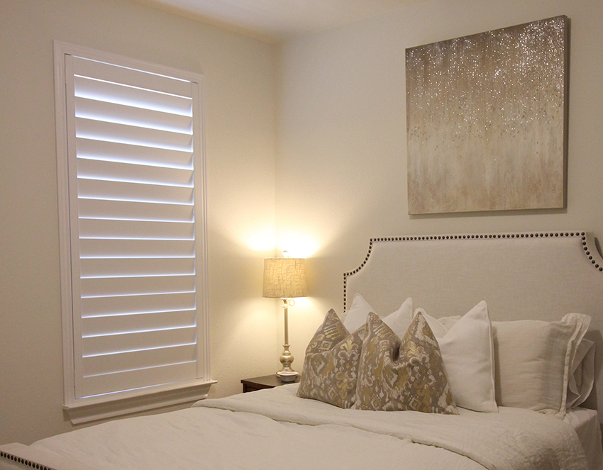 interior shutters on bedroom window for room darkening in San Antonio TX