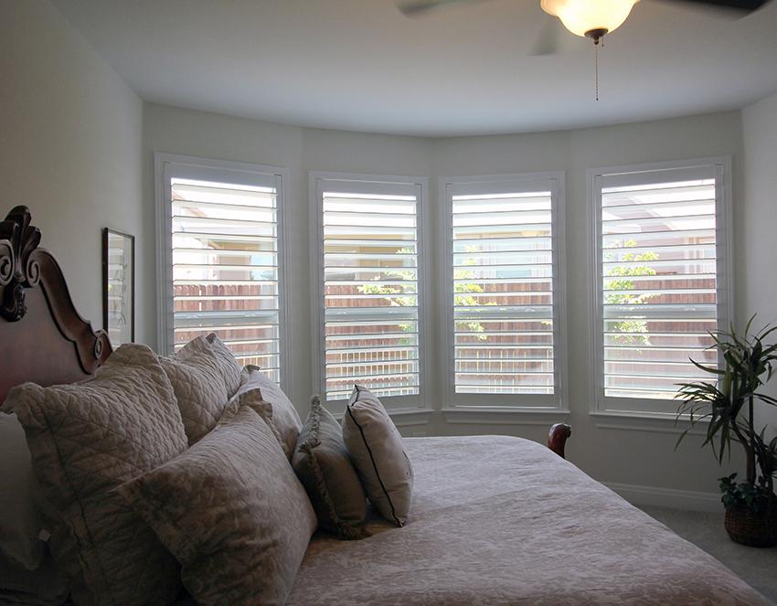 bay window area of bedroom with plantation shutters in San Antonio TX