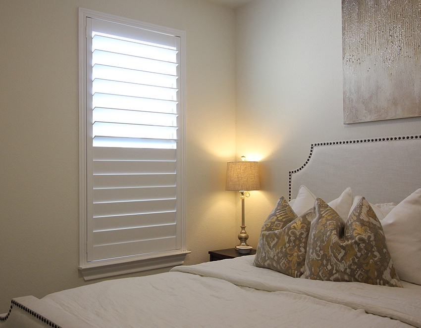 golden bedroom with white plantation shutters San Antonio