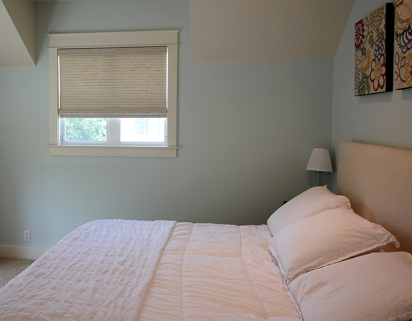 baby blue bedroom with hunter douglas provenance woven wood shade in San Antonio TX