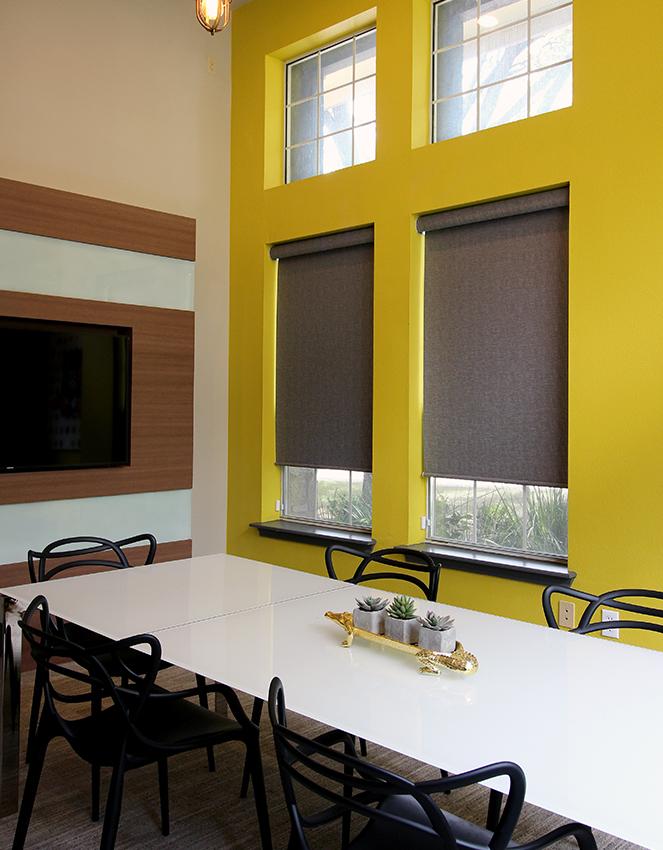 yellow office with hunter douglas grey roller shades San Antonio
